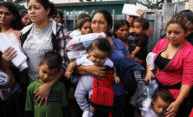 Dozens of Central American women and children crowded in the frame.