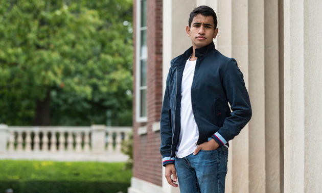 portrait of Brian Basu standing outside Rush Rhees Library